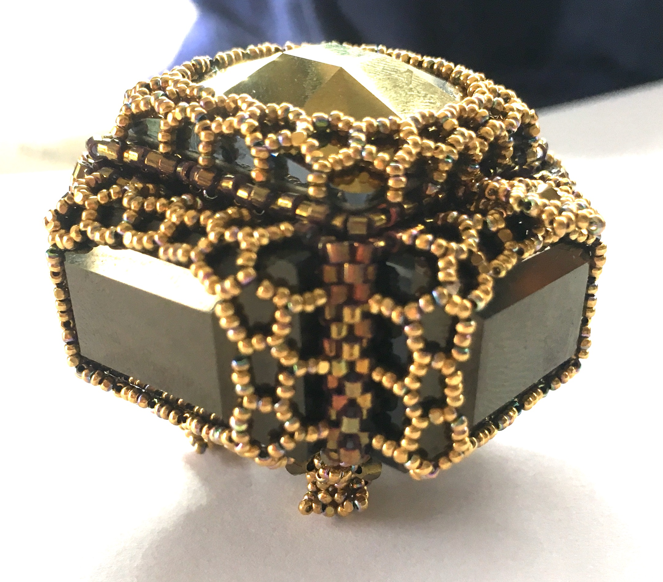 Boîte à Bijoux in Dorado and Jet Nut is a delicate beaded box.